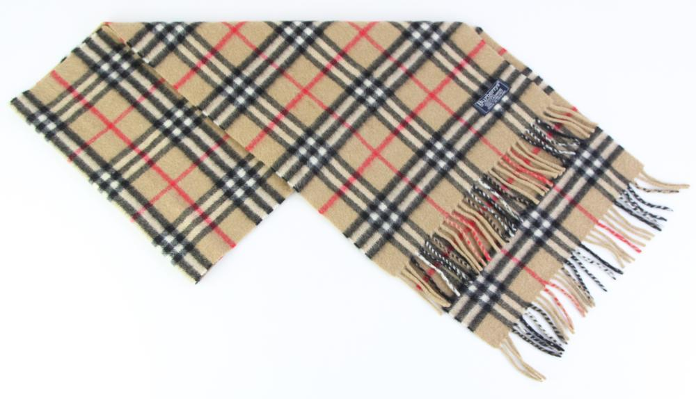 A VINTAGE BURBERRYS OF LONDON CASHMERE NOVA CHECK SCARF; with label, 30 x 144cm with fringe.