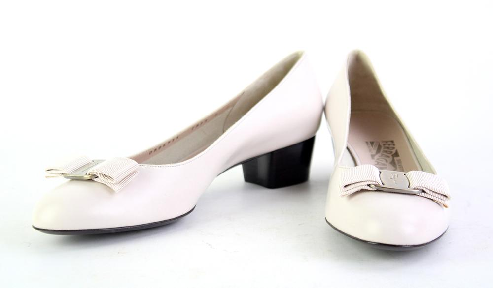 A PAIR OF FERRAGAMO SHOES; off white leather with silver metal and ribbon bows, stamped, DB86715 C839, size 9C.