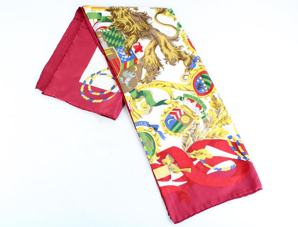 GIANFRANCO FERRE SILK SCARF; depicting coat of arms with lions and virtues, with rolled edges and label, 87 x87cm.