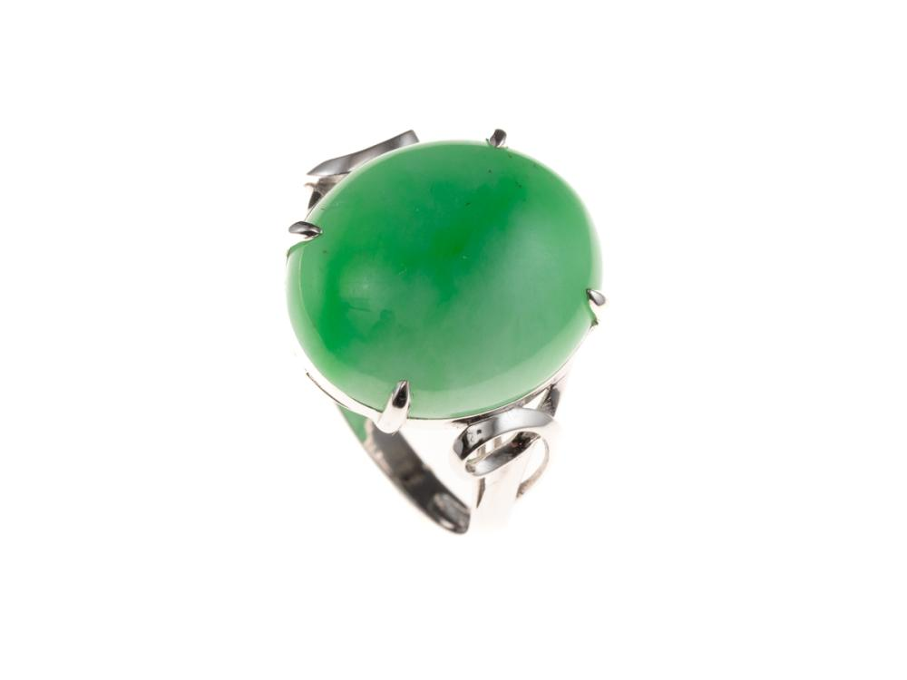AN 18CT WHITE GOLD JADE RING; claw set with a 16 x 13.7mm cabochon green jade (approx. 10ct), on fancy shoulders, size N, wt. 4.57g.