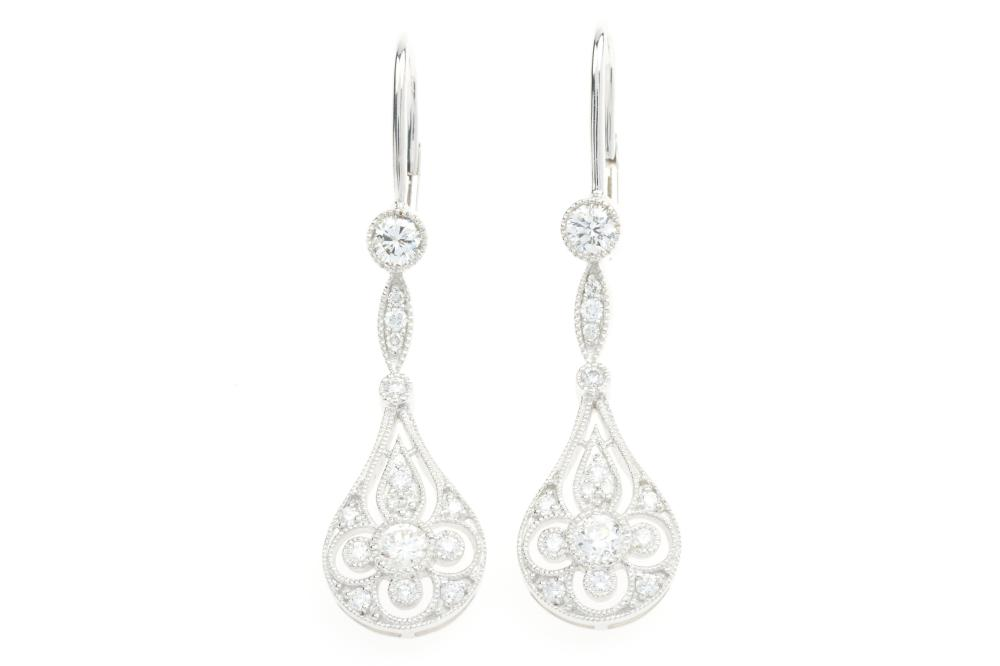 A PAIR OF DECO STYLE 18CT WHITE GOLD DIAMOND EARRINGS; 30mm articulated pierced pendeloque drops set with 32 round brilliant cut dia...