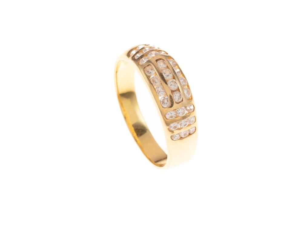 AN 18CT GOLD DIAMOND RING; channel set with 30 round brilliant cut diamonds totalling an estimated 0.54ct, size N1/2, wt. 3.59g.