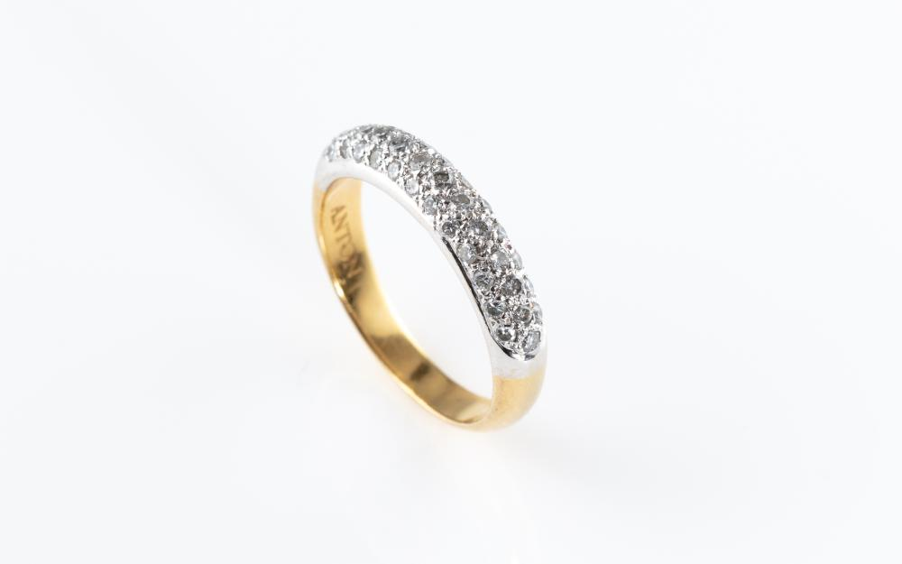 AN 18CT GOLD HALF HOOP DIAMOND RING; pave set with 37 round brilliant cut diamonds across the top, by Anton jewellers, size M, wt. 3...