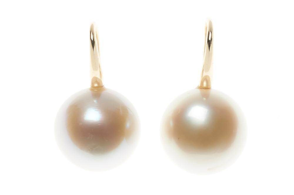 A PAIR OF SOUTH SEA PEARL EARRINGS; 13.5mm near round cultured pearls with very good lustre to 9ct gold shepherds hook fittings.