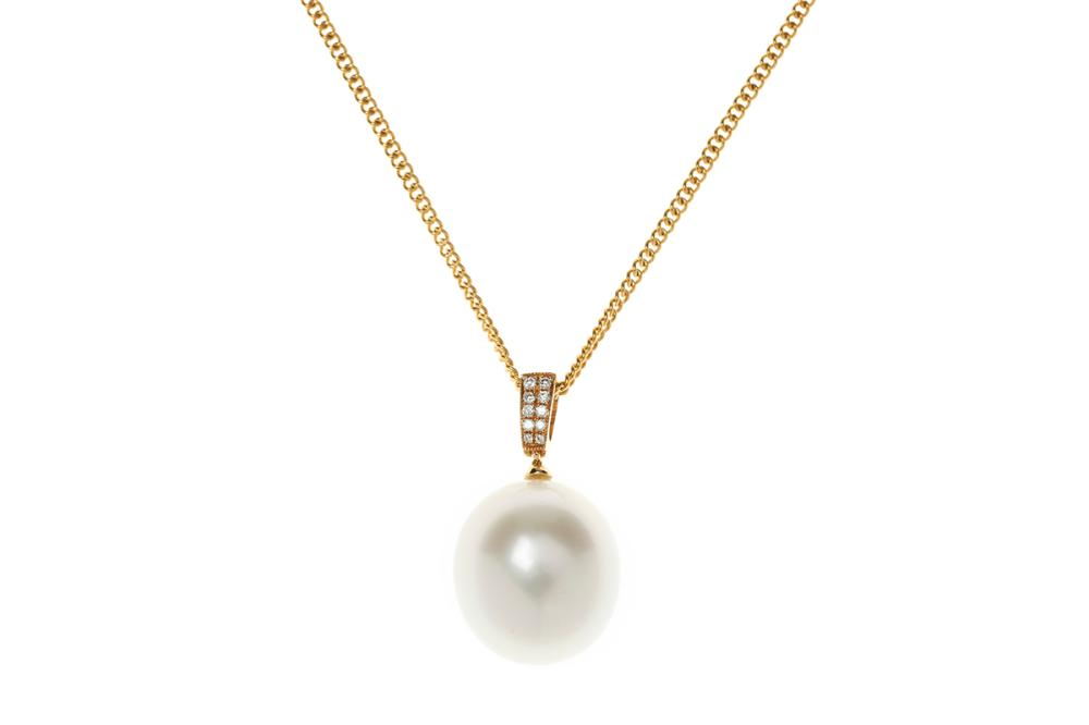 AN 18CT GOLD SOUTH SEA PEARL AND DIAMOND PENDANT; 15 x 13.5mm oval cultured pearl of good colour and lustre to bale set with 10 roun...