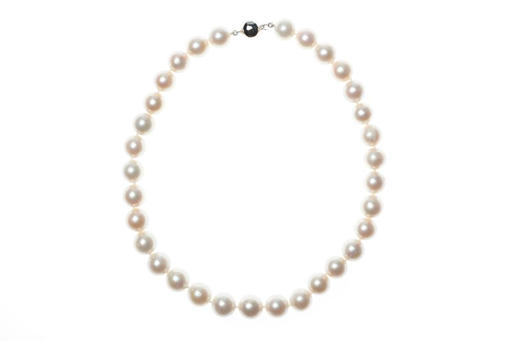 A FRESHWATER PEARL NEACKLACE; 12-13mm near round cultured pearls of good white colour and lustre to a sterling silver ball clasp, le...