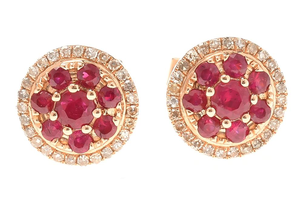A PAIR OF RUBY AND DIAMOND CLUSTER STUD EARRINGS; set in 18ct gold with central ruby clusters totalling 0.58ct, to surrounds of sing...