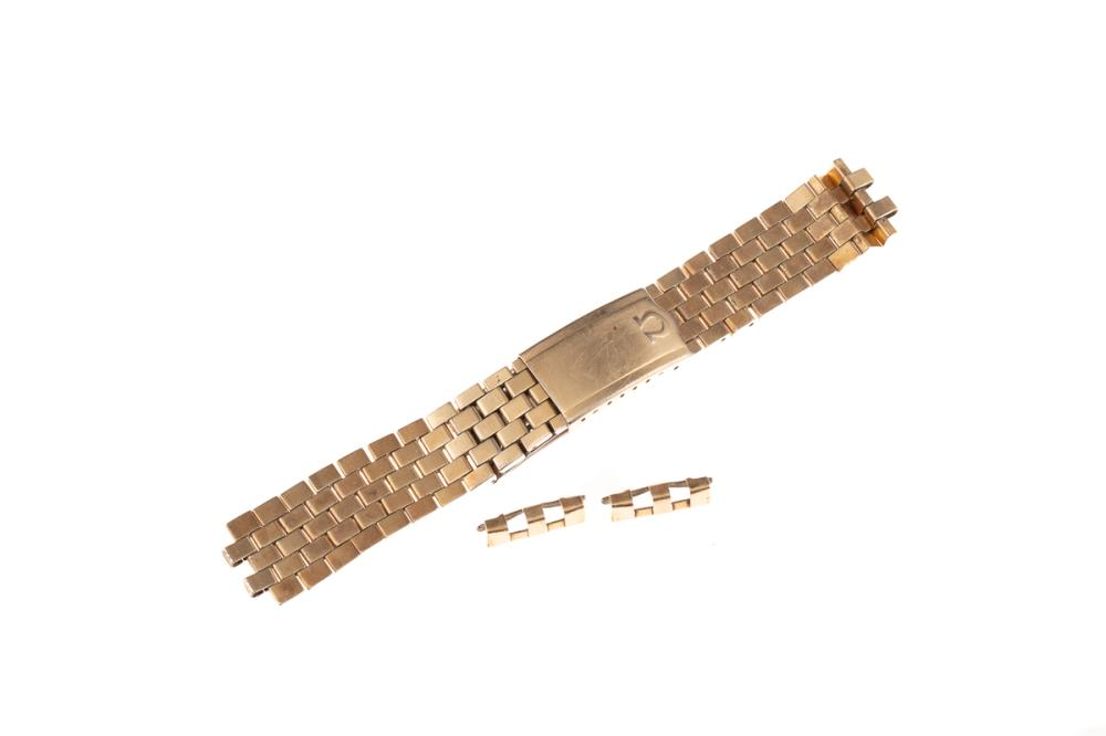 AN OMEGA GOLD PLATED STAINLESS STEEL WATCH BAND; 19mm wide brick pattern no. 12. ref. 1040, length 150mm, needs adjusting.