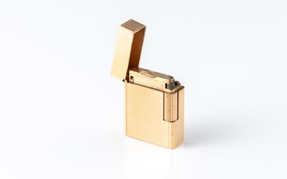 A DUPONT GOLD PLATED LIGHTER; engine turned pattern, no. K4CF59, made in France.