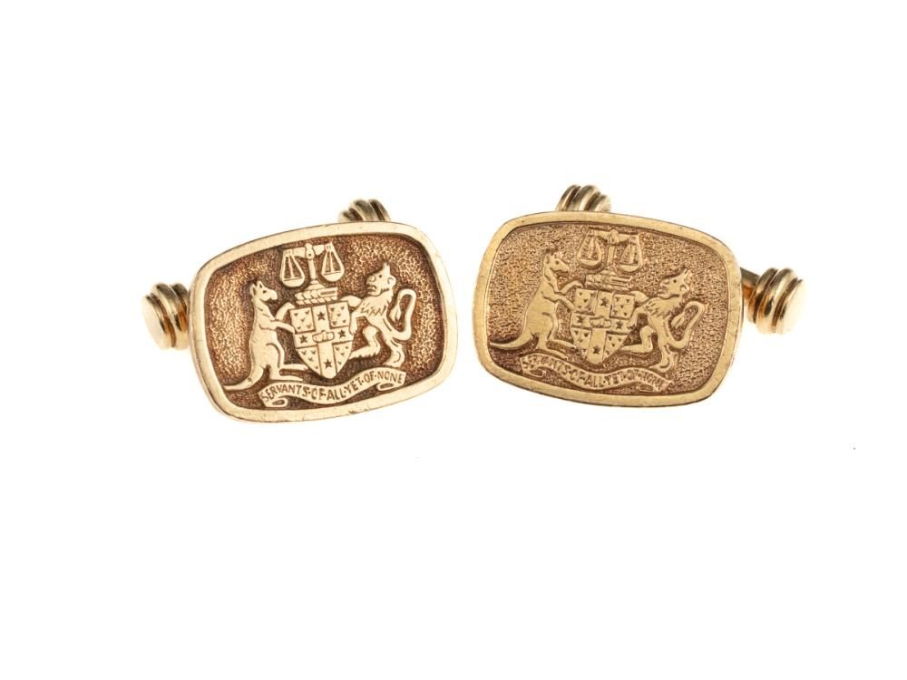 A PAIR OF 9CT GOLD CUFF LINKS; featuring The New South Wales Bar Association Coat of Arms, wt. 13.8g.