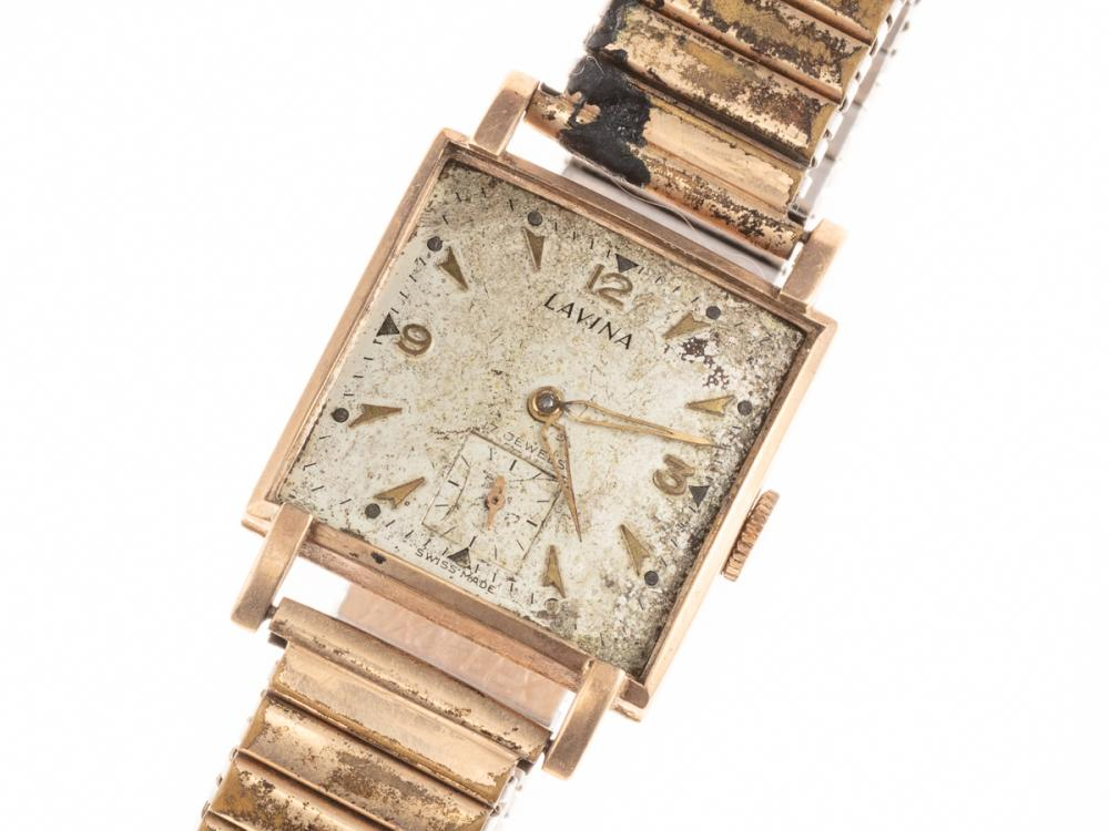 A VINTAGE 9CT GOLD LAVINA WRISTWATCH; square form, worn dial, subsidiary seconds, metal band, not working.