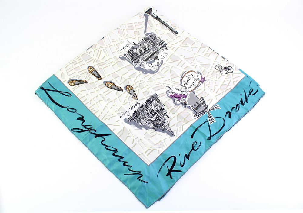 A LONGCHAMP SILK SCARF RIVE GAUCHE;  showing map of Paris with dark turquoise border, rolled edges and tag, 88 x 88cm.