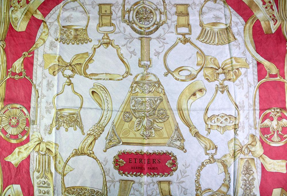 AN HERMES ETRIERS SILK SCARF; signed F de La Perriere, with label and rolled edges, 90 x 90cm.