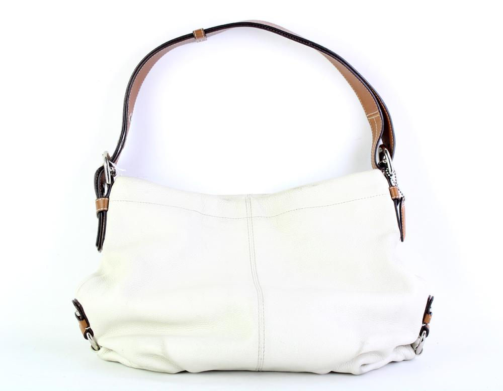 A COACH PEBBLE LEATHER CONVERTIBLE DUFFLE/ CROSSBODY SHOULDER BAG; in cream with tan handle that can be worn two ways, with dusky pi...