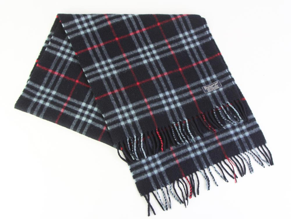 A VINTAGE BURBERRYS OF LONDON WOOL AND CASHMERE CHECK SCARF; on black ground with label, 32 x 140cm incl. fringe.