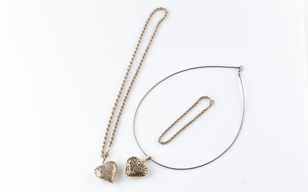 TWO SILVER HEART PENDANT NECKLACES AND BRACELET; pierced heart pendants in silver and silver gilt, 1 on an Omega chain (45cm), other...