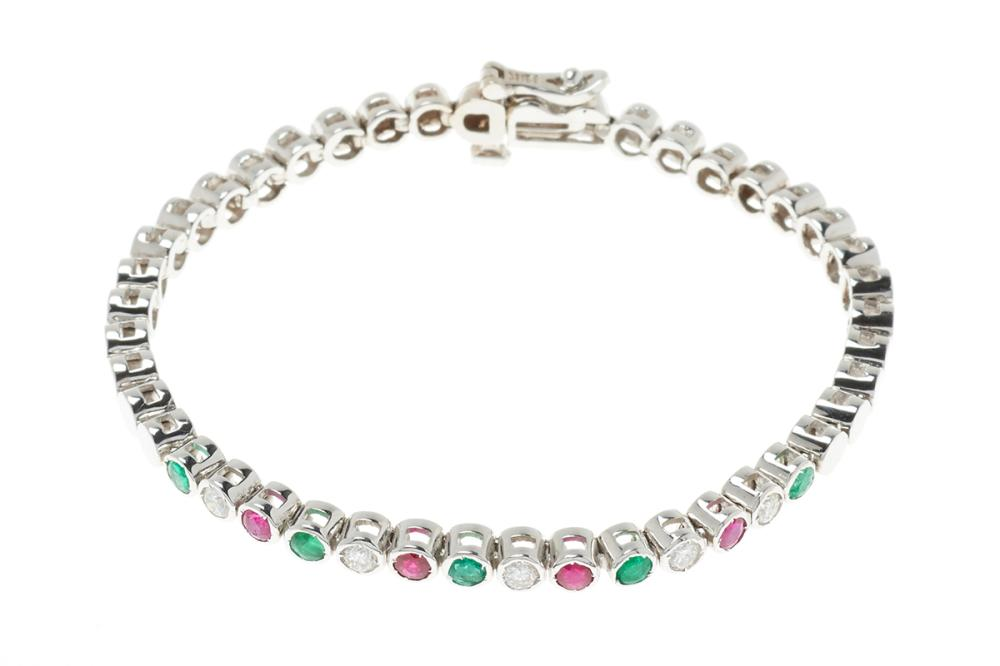 AN 18CT WHITE GOLD DIAMOND AND GEMSET BRACELET; centring a row of alternately set emeralds round brilliant cut diamonds and rubies t...
