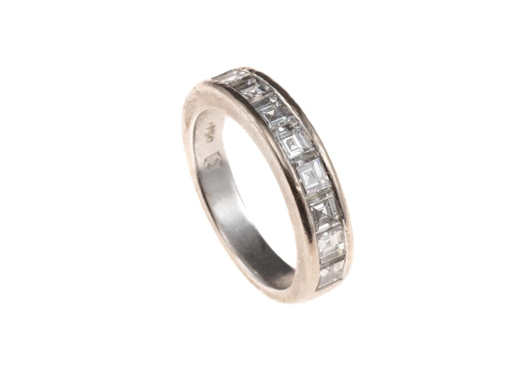 AN 18CT WHITE GOLD HALF HOOP DIAMOND RING; set with 9 square cut diamonds totalling approx. 1.60ct, size L1/2, wt. 6.15g.