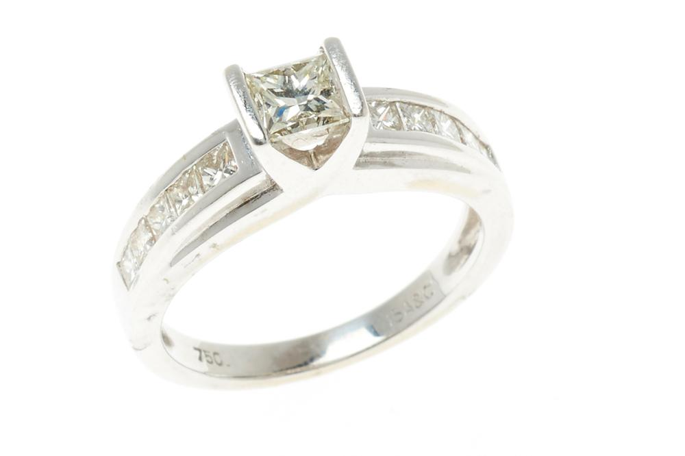 AN 18CT WHITE GOLD DIAMOND ENGAGEMENT RING; centring a princess cut diamond of approx. 0.50ct, M/VS to shoulders set with 10 princes...