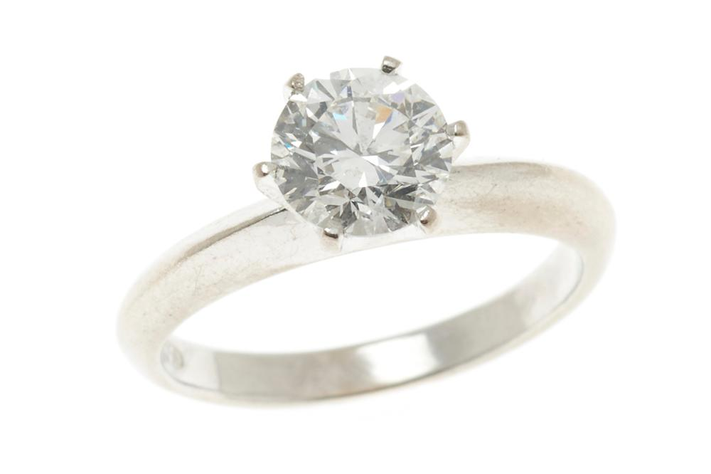 AN 18CT WHITE GOLD SOLITAIRE DIAMOND RING; claw set with a round brilliant cut diamond estimated in the setting as 0.985ct, F/P1, si...