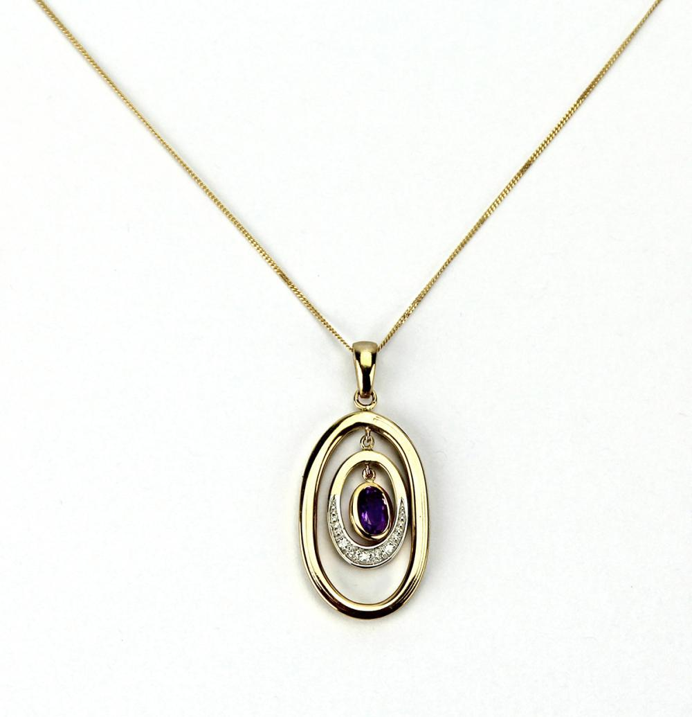 A 9CT GOLD AMETHYST AND DIAMOND PENDANT NECKLACE; articulating pendant set with an oval cut amethyst and 5 single cut diamonds on a...