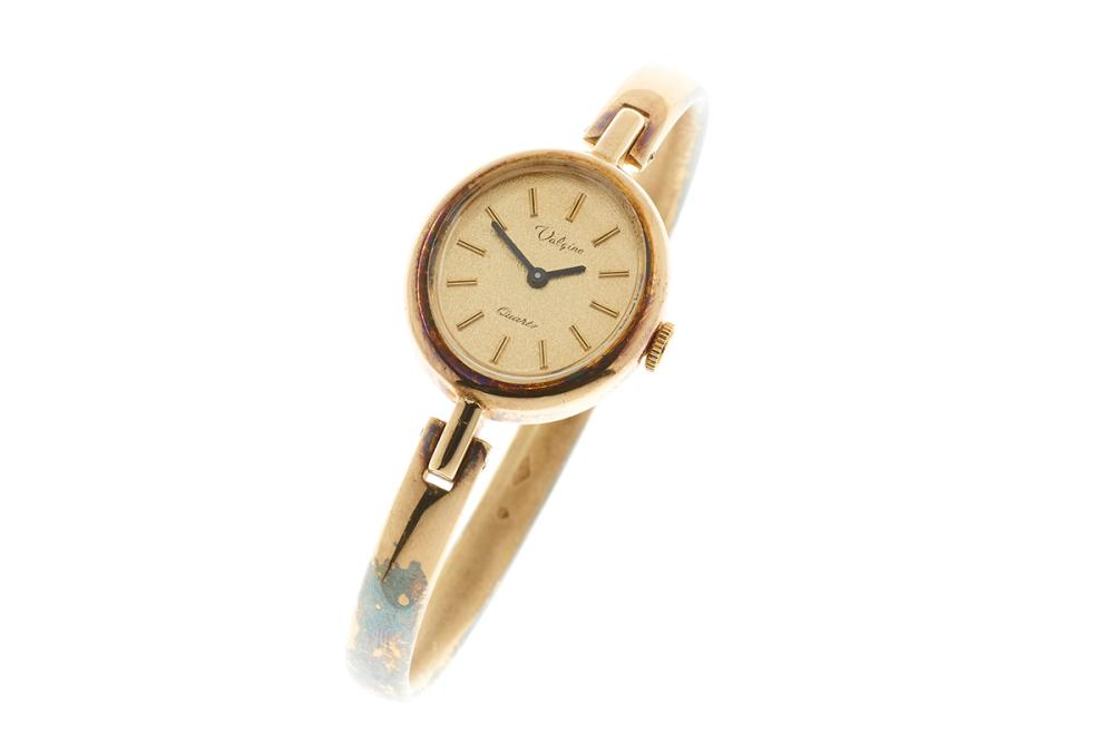 A VALGINE SILVER GILT LADY'S BANGLE WATCH; frosted oval dial, applied markers, on a quartz movement, new battery.