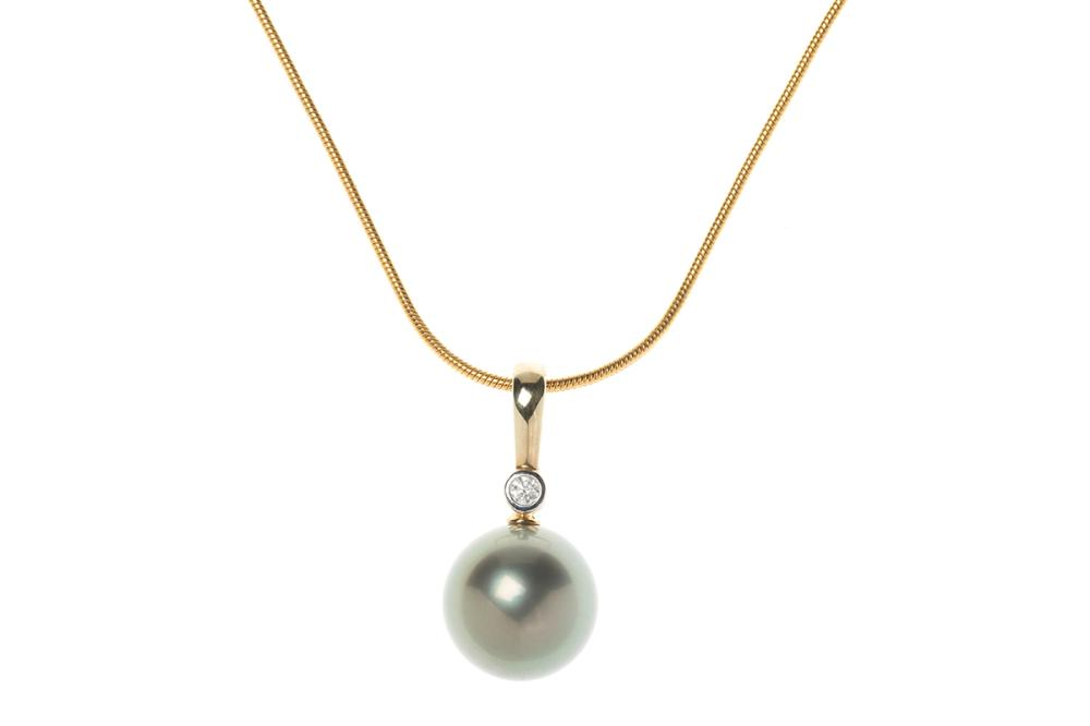 A TAHITIAN PEARL AND DIAMOND ENHANCER; 13.75mm round cultured pearl of very good lustre and colour on a 9ct gold hinged bale collet...