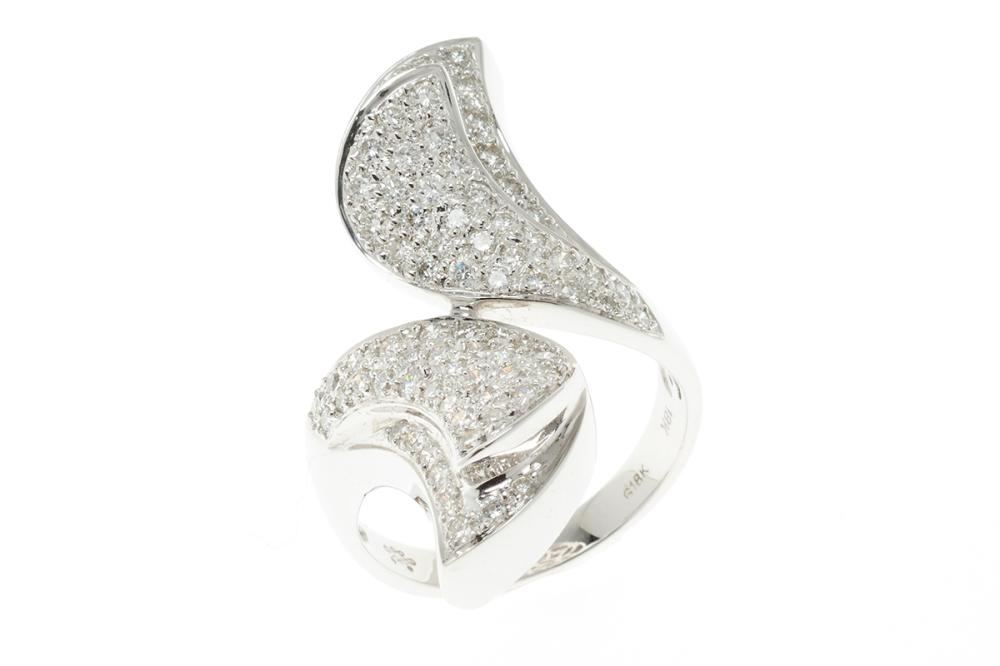 AN 18CT WHITE GOLD DIAMOND RING; stylised by-pass mount pave set with 76 round brilliant cut diamonds, size M, width across top 32mm...