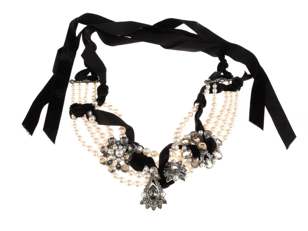 A LANVIN NECKLACE; 5 strands of faux pearls to 3 cluster, drop and bars set with pastes, faux pearls and crystals (1 stone missing,...