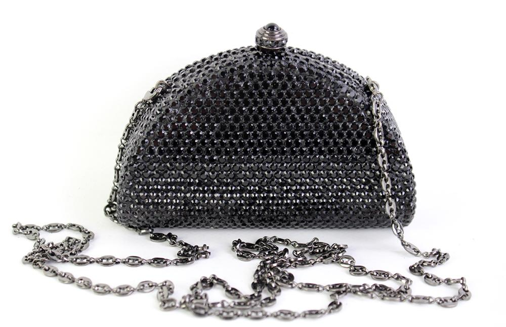 A BLACK CRYSTAL COCKTAIL PURSE; with fold away gunmetal tone chain, 12 x 4 x 9cm, with spare crystals.