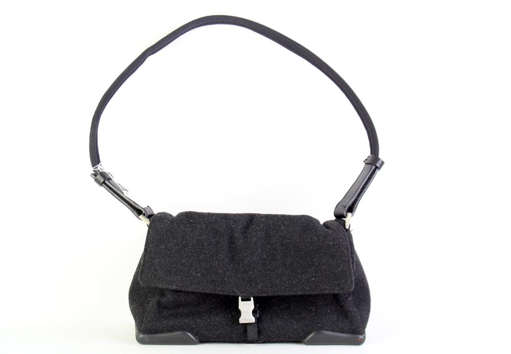 A BLACK PRADA SHOULDER BAG; with wool and nylon exterior and suede interior with tag no. RN 98339 CA34767, size 24 x 9 x 16cm.