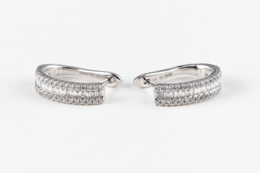 A PAIR OF 18CT WHITE GOLD DIAMOND HOOP EARRINGS; stirrup shape hoops set with round brilliant and baguette cut diamonds.