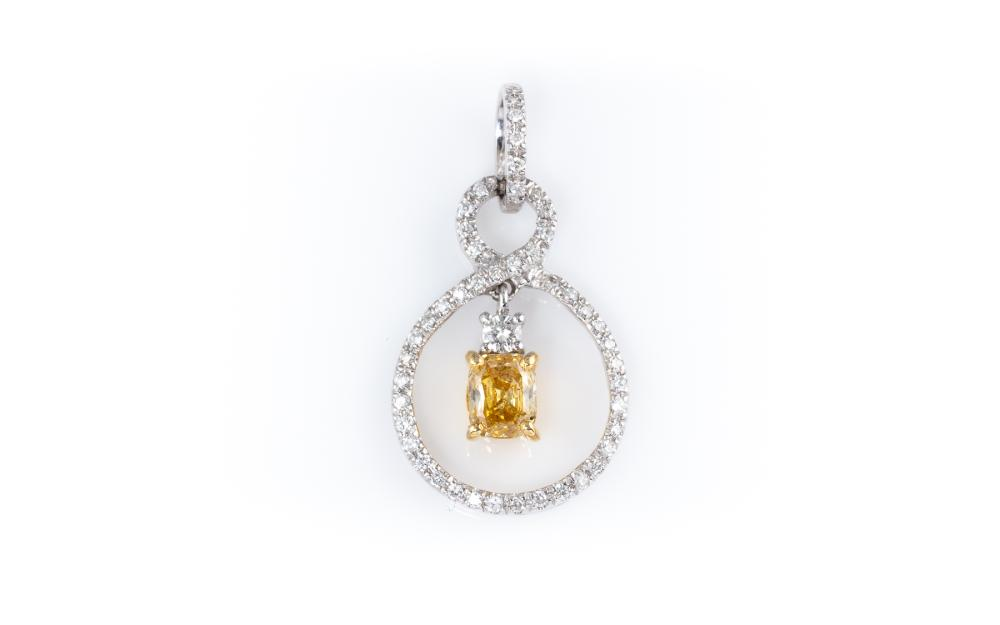 AN 18CT WHITE GOLD YELLOW AND WHITE DIAMOND PENDANT; centring a fancy yellow cushion cut diamond of approx. 0.47ct, topped by a whit...