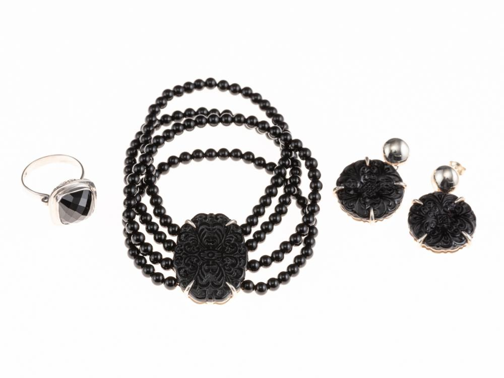 ONYX AND SILVER JEWELLERY; matched bracelet and earrings with carved plaques, bracelet with 4 strands of beads on elastic, earrings...