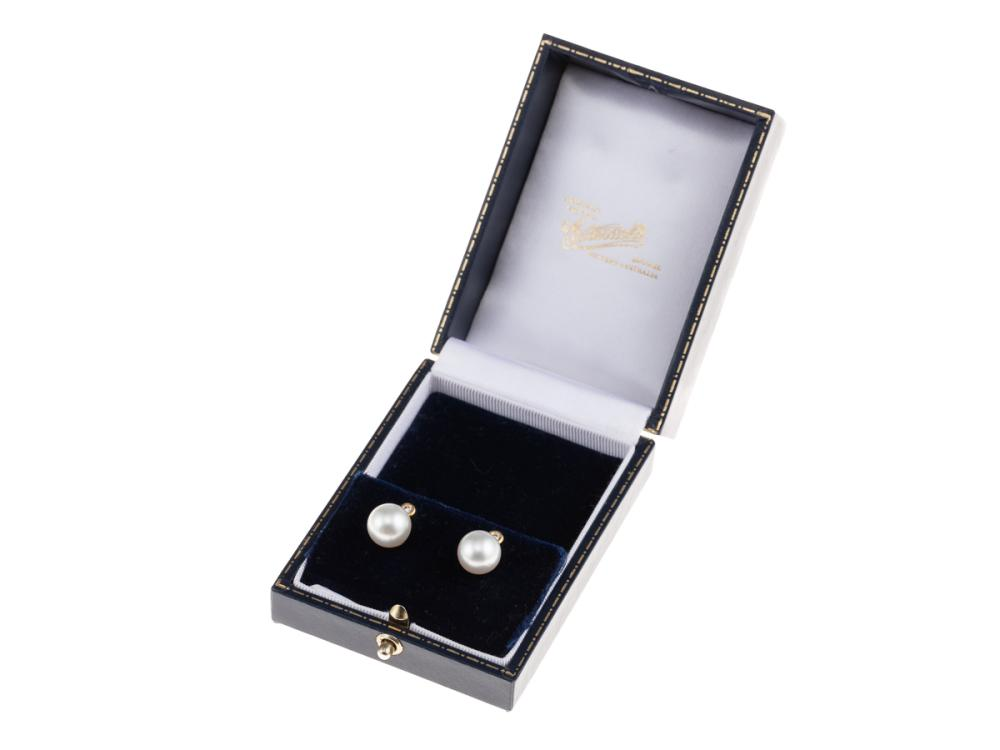 A PAIR OF SOUTH SEA PEARL AND DIAMOND STUD EARRINGS; 10.4 & 10.5mm round cultured pearls of fine colour and lustre, each surmounted...