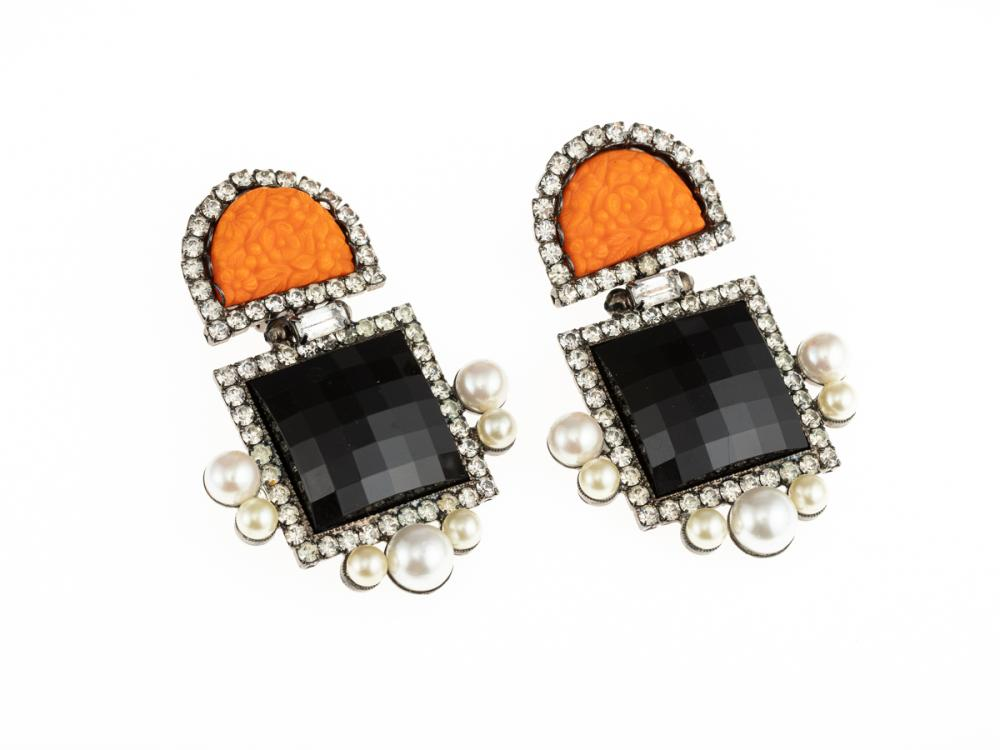 A PAIR OF LAWRENCE VRBA CLIP ON EARRINGS; set with floral orange crescent pastes and square checkerboard French jet, all surrounded...
