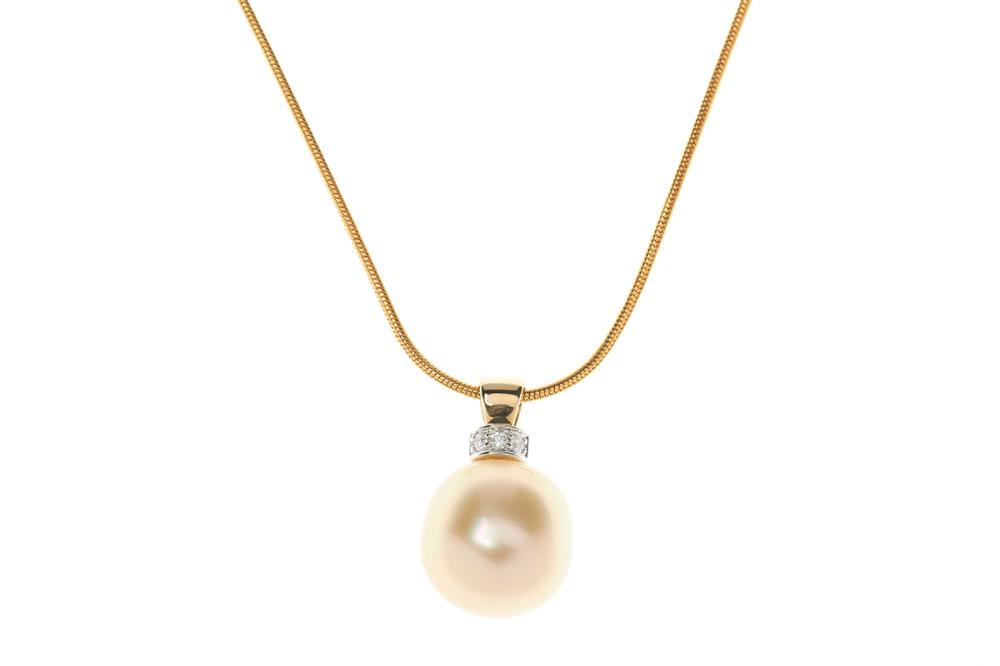 A GOLDEN SOUTH SEA PEARL AND DIAMOND PENDANT; 15.4-15.1mm off round cultured pearl of good light golden colour and fine lustre to 18...