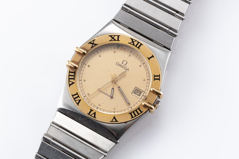 AN OMEGA CONSTELLATION WRISTWATCH; ref; 3961070 in gold and stainless steel with matte dial, center seconds, date, 18ct gold bezel w...