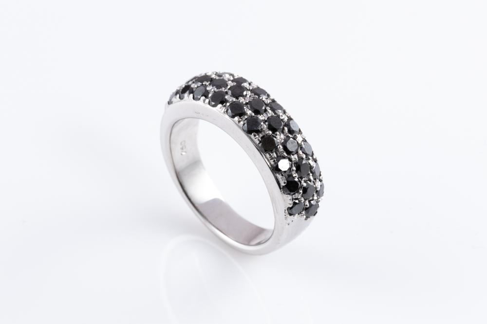 A HALF HOOP BLACK DIAMOND RING; set in 18ct white gold with 31 round brilliant cut black diamonds totalling approx. 0.93ct, size L,...