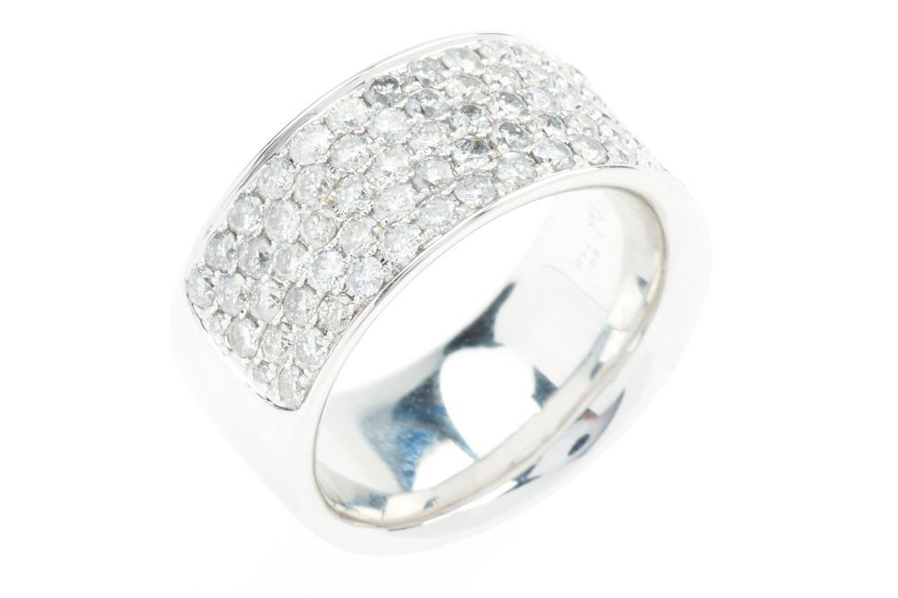 AN 18CT WHITE GOLD HALF HOOP DIAMOND RING; pave set with 91 round brilliant cut diamond totalling 1.90ct, size M/N, wt. 11.04g.