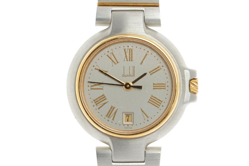 A DUNHILL MILLENIUM LADY'S QUARTZ WRISTWATCH; grey dial, Roman numerals, center seconds, date, gold plated bezel crown and link sect...