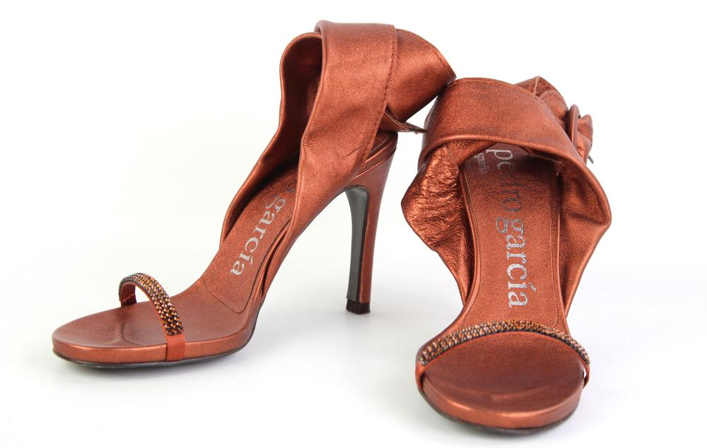 A PAIR OF PEDRO GARCIA ABBY HIGH HEEL SANDLES; in copper metal nappa leather, front straps studded in brown diamantes, size 37, with...