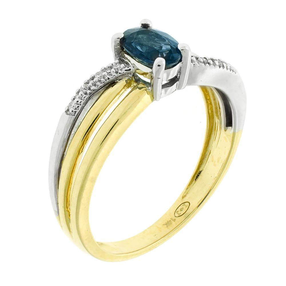 A 14CT GOLD SAPPHIRE AND DIAMOND RING; centring an oval cut blue sapphire between split shoulders set with eight round brilliant cut...