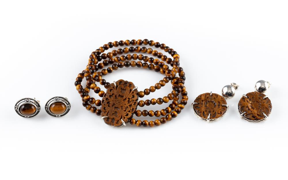 TIGERS EYE SILVER JEWELLERY; matching bracelet and earrings suite with carved tigers eye plaques, bracelet to 4 rows of round beads...