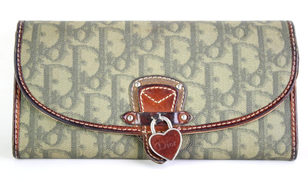 CHRISTIAN DIOR MONOGRAM WALLET; printed canvas with heart Dior charm, with leather trim and interior Stamped Made in Italy 02-LU- 10...