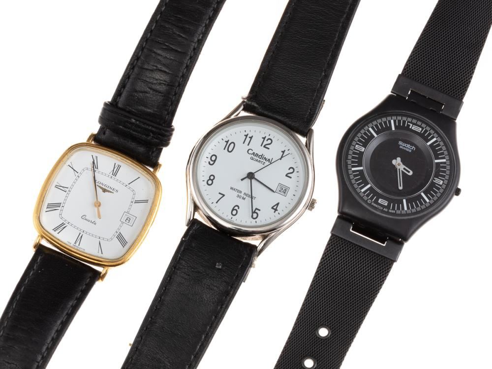 A GROUP OF GENT'S WATCHES; a Swatch quartz with black dial, white markers and hands, black band, a Cardinal quartz with center secon...