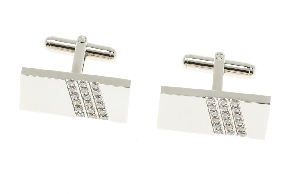 A PAIR OF STAINLESS STEEL GENT'S STONE SET CUFF LINKS; 25 x 12mm plaques set with zirconias.