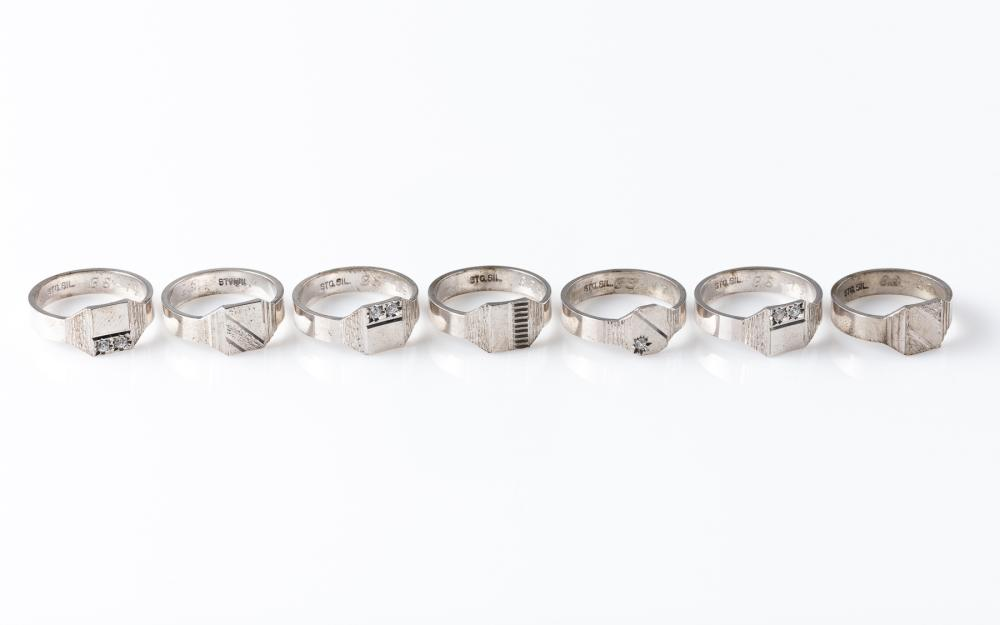 SEVEN GENT'S SILVER SIGNET RINGS; some set with zirconias, sizes S-U, total wt. 29.3g.