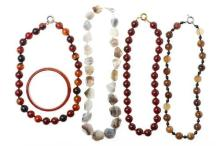 AGATE BANGLE AND BEAD NECKLACES; half round bangle (6.5cm diameter), round, faceted and polished beads, lengths 46-51cm.