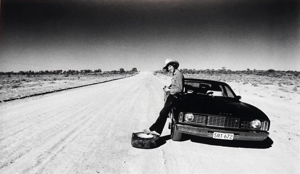Artist Unknown - Flat tire on the Silver City Highway in Tibooburra, NSW 1985 73 x 110 (frame size)